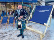 Stuart Samson playing the bagpipes outside the Aberdeen Standard Investments Cafe at the World Economic Forum in Davos.