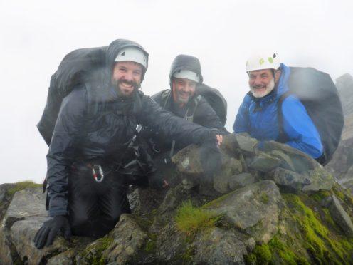 Paul, Matt, and father David Choat at the summit of  Sgùrr a' Mhadaidh.