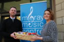 Moray Council's acting head of music instruction service Alexander Davidson and Moray Food Plus' volunteer development officer Gillian Pirie.