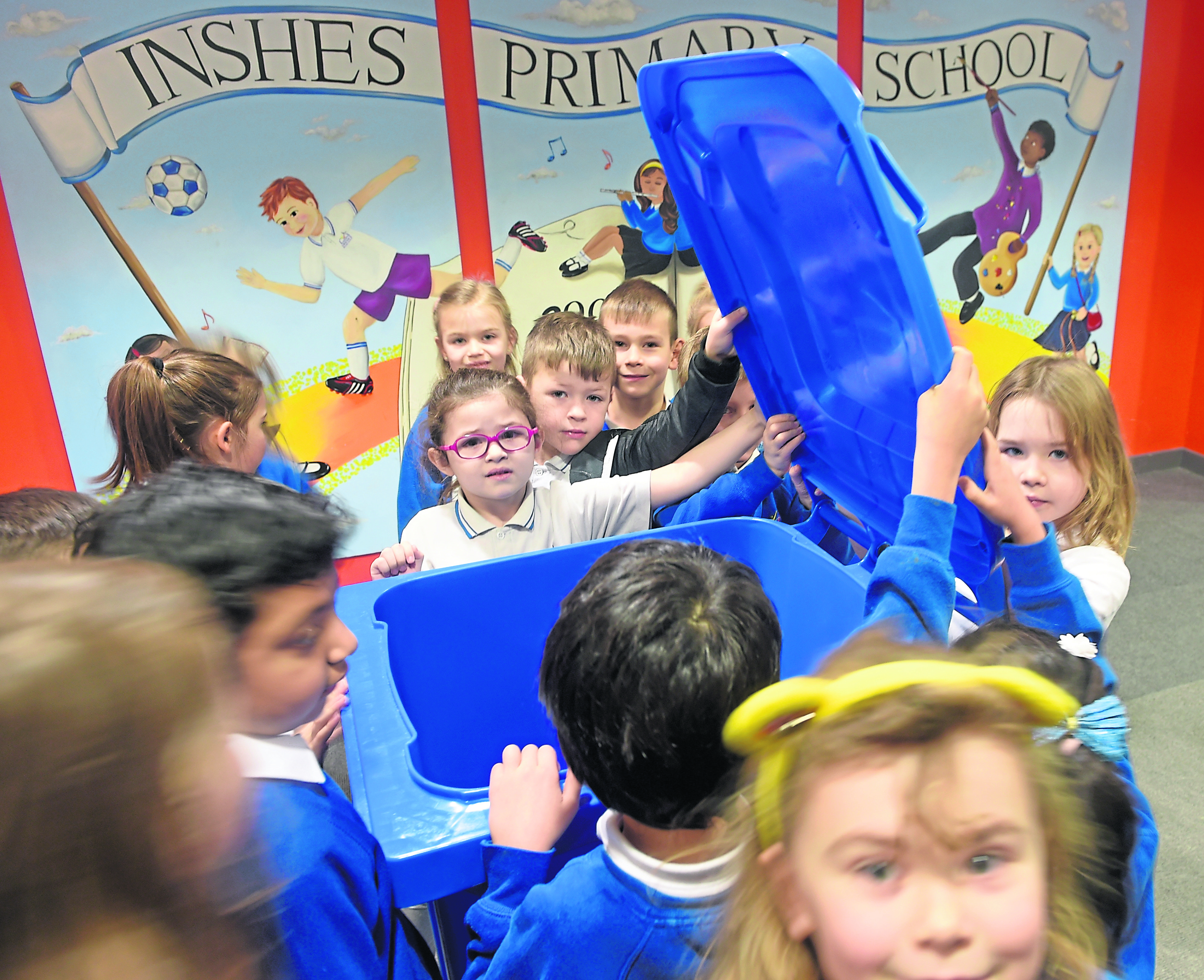Pupils at Inshes Primary School, Inverness take a first look at their new blue recycling bin which has been installed in the school. Picture by Sandy McCook