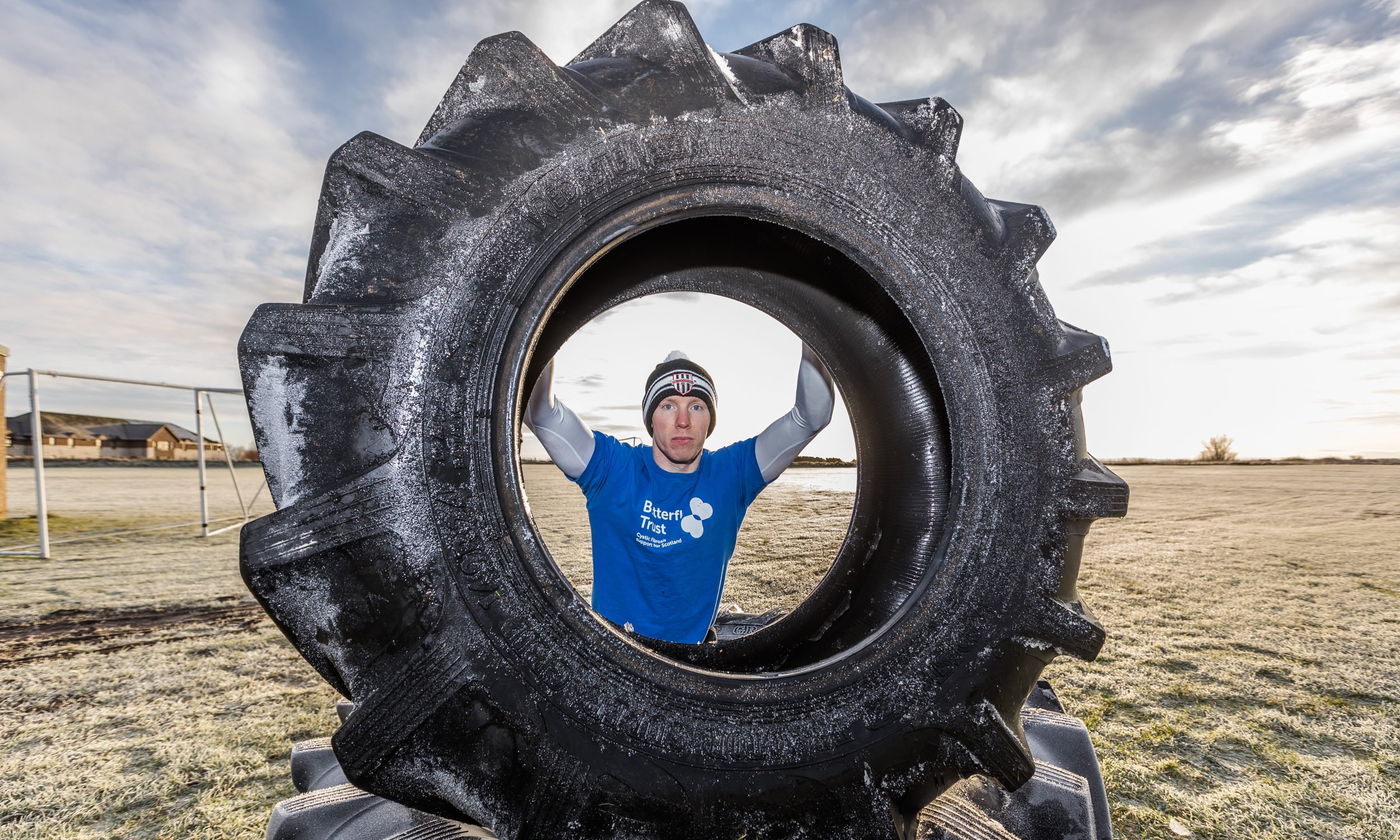 Cameron Hook trains with his tractor tyre which he will be flipping right the way to the top of Ben Bhraggie. He is raising funds for The Butterfly Trust in aid of Cystic Fibrosis Support Scotland and Dornoch City FC.
