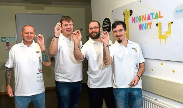 Four pals broke a Guinness World Record for the longest doubles darts match.  Pictured from left, Mark Taylor, Neil Munro , Dave Matthew and Lewis Grant.