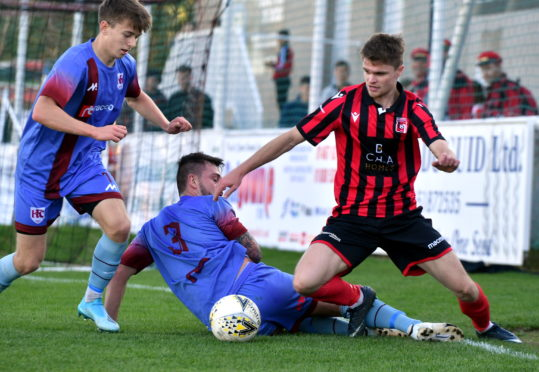 Gregor MacDonald (left) in action for Keith against Inverurie Locos.