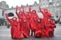 Extinction Rebellion protestors The Red Rebel Brigade. Picture by Darrell Benns.