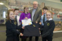 Monica Malet, chief executive of Scottish Fairtrade Forum Martin Rhodes and St Joseph pupils in their sustainable uniforms
