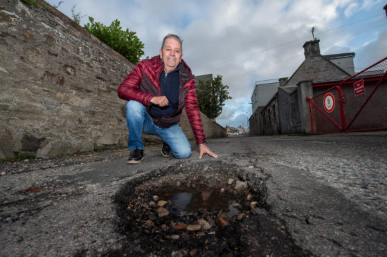 Councillor Gordon Cowie on Harbour House Lane in Buckie.   Pictures by JASON HEDGES