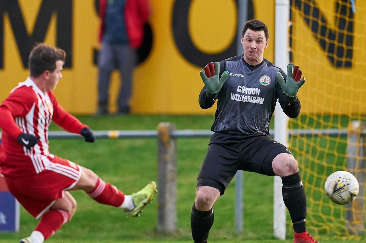 Forres GK, Stuart Knight cannot save Formartine's Conor Gethins strike.
