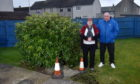 Hazel Moir and Robert Knowles complained about the uncovered manhole in her garden.