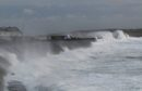 Wild seas flinging big stones and debris forced a main coastal route on Lewis to close during Storm Brendan on Monday.