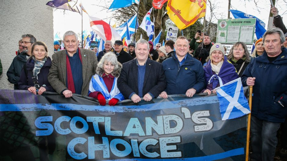 SNP MP's Drew Hendry and Ian Blackford along with others ahead of the march through the Highland capital.