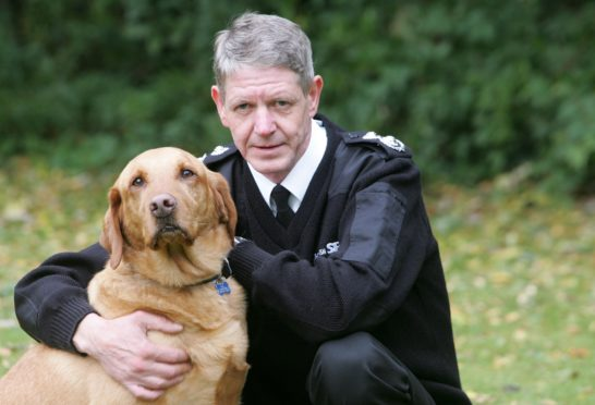 Scottish SPCA Chief Superintendent Mike Flynn with Monty the Golden Labrador who has previously been sedated due to fireworks.