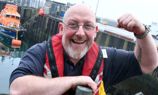 Vic Sutherland is raising money for the RNLI by lifting the total weight of each lifeboat class. Picture by Chris Sumner.