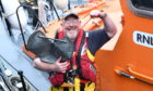 RNLI Fraserburgh Coxswain, Vic Sutherland, getting in practise by lifting a lifeboat anchor. Picture by Chris Sumner.