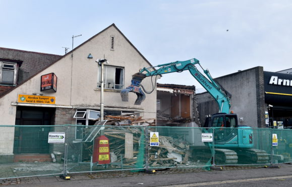 Pictured is the demolition of the Aberdeen Transport and Soclial Club, Canal Road, Aberdeen. Arnold Clark has already been granted a building warrant to demolish Aberdeen Transport Club in the city's Canal Road. But the motor group now has lodged a planning application to build a car park, wash bay and fuelling station on the site, which is next door to its car and rental business. Picture by DARRELL BENNS  Pictured on 09/01/2020    CR0018219