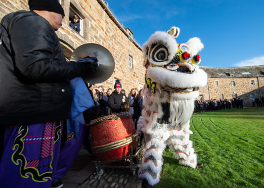 Lion dancing group Glasgow Hong Lok Dragon and Lion Dance Troupe perform for pupils and staff at Gordonstoun School in the Round Square.