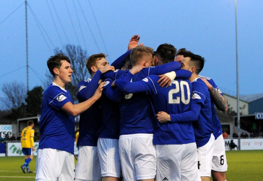 Jamie Masson celebrating with team mates after scoring to make it 3-0.  Picture by KENNY ELRICK