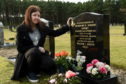 Lyndsay Broadley at her grandmother's grave in Lossiemouth.