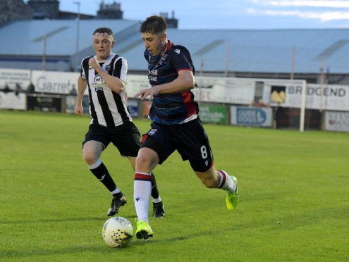 Mark Gallagher in action for Ross County against Fraserburgh in the Challenge Cup.