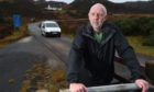 Assynt Community Council secretary Phil Jones who is upset at the council not consulting residents about new NC500 signs. Picture by Sandy McCook.
