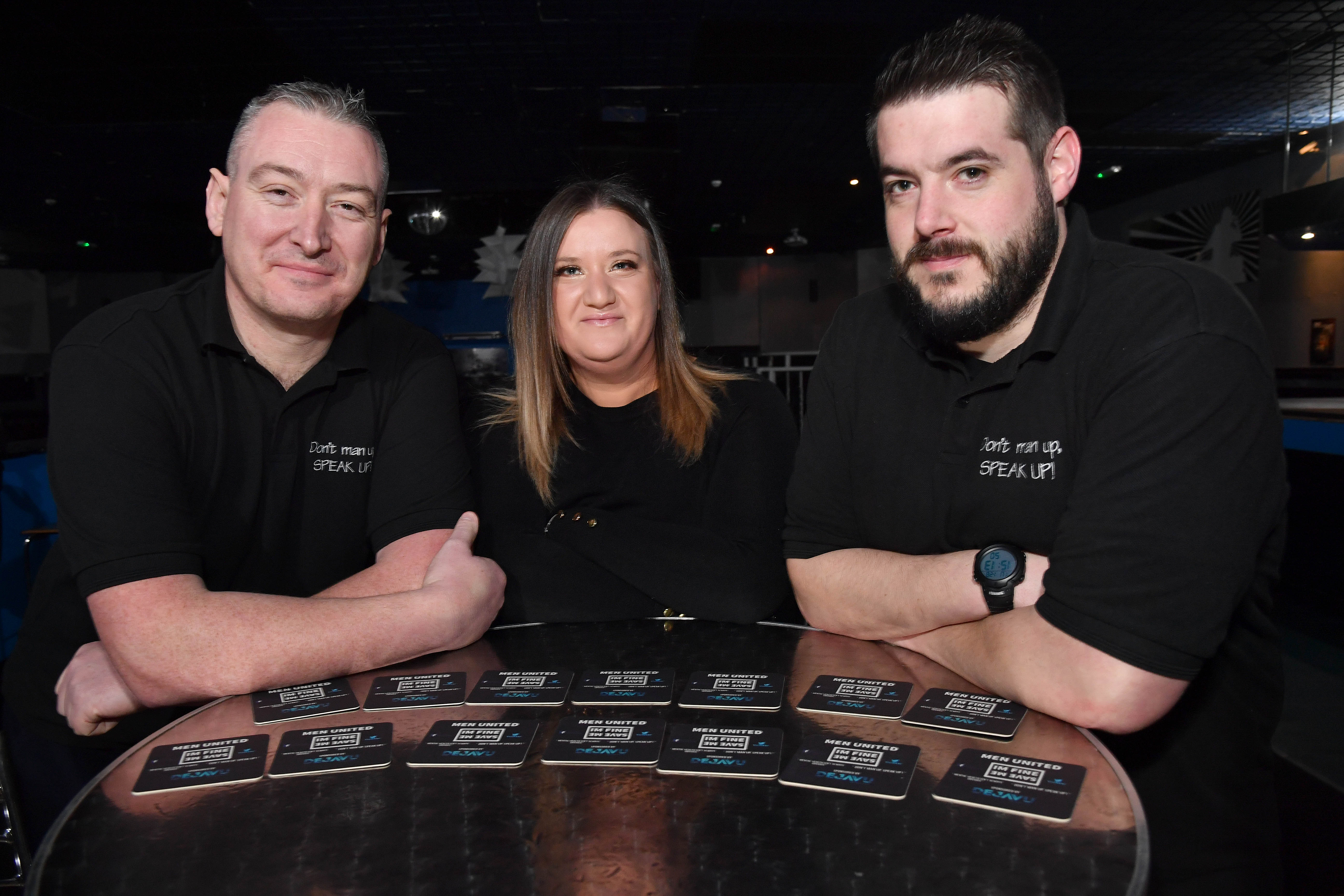 MEN UNITED'S SANDY GARVOCK (L) AND AARON RITCHIE WITH DEJA VU MANAGER NADINE O'ROURKE AND THE NEW BEER MATS.