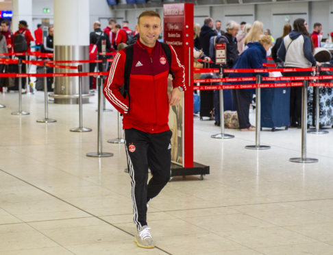 Dylan McGeouch at Glasgow Airport ahead of the team's January training camp in Dubai.