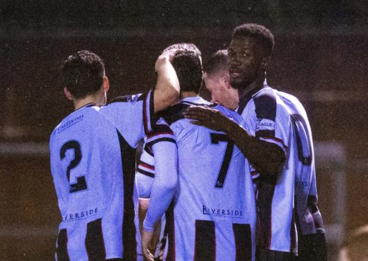 Elgin come together to celebrate Rabin Omar's goal during the Ladbrokes League Two match between Annan Athletic and Elgin City