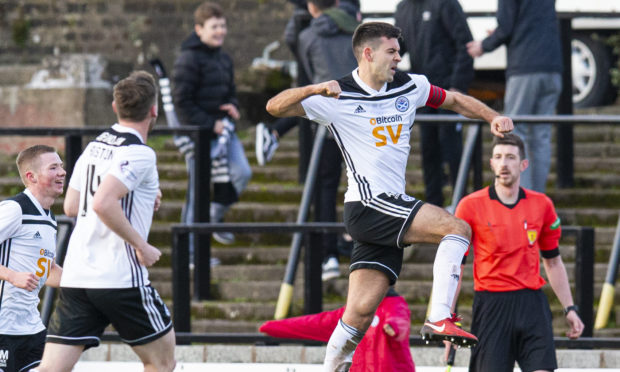 Steven Bell celebrates netting for Ayr.
