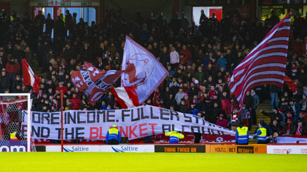 Dons fans hold up a banner in the Red Shed at half-time during the William Hill Scottish Cup fourth-round tie between Aberdeen and Dumbarton.