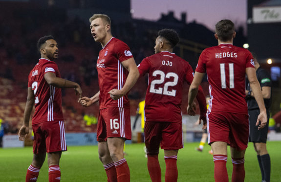 Sam Cosgrove, second left, with team-mates including Funso Ojo after scoring.