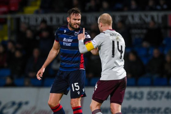 Keith Watson and Steven Naismith exchange verbals during the clash at Victoria Park between Ross County and Hearts