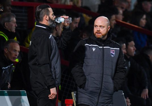 Ross County co-managers Stuart Kettlewell (L) and Steve Ferguson during the Ladbrokes Premiership match between Ross County and Hearts at the Global Energy Stadium.