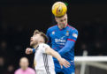 Inverness' Kevin McHattie, right, wins a header against Aaron Drinan during a Ladbrokes Championship match between Ayr United and Inverness Caledonian Thistle at Somerset Park.