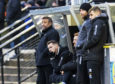 Jamie McCart (centre) next to manager John Robertson during Saturday's game with Ayr United.