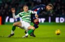 Celtic's Jozo Simunovic and Lee Erwin in action during the Ladbrokes Premiership match between Celtic and Ross County