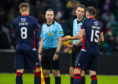 Keith Watson protests with referee Kevin Clancy over the awarding of a first-half penalty during the Ladbrokes Premiership match between Celtic and Ross County.