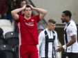Aberdeen's Scott McKenna looks dejected as his shot is palmed out for a corner during the Ladbrokes Premiership match between St Mirren and Aberdeen