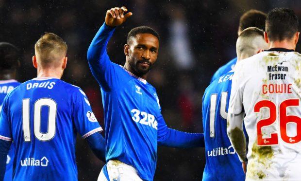 Jermain Defoe celebrates after netting for Rangers.