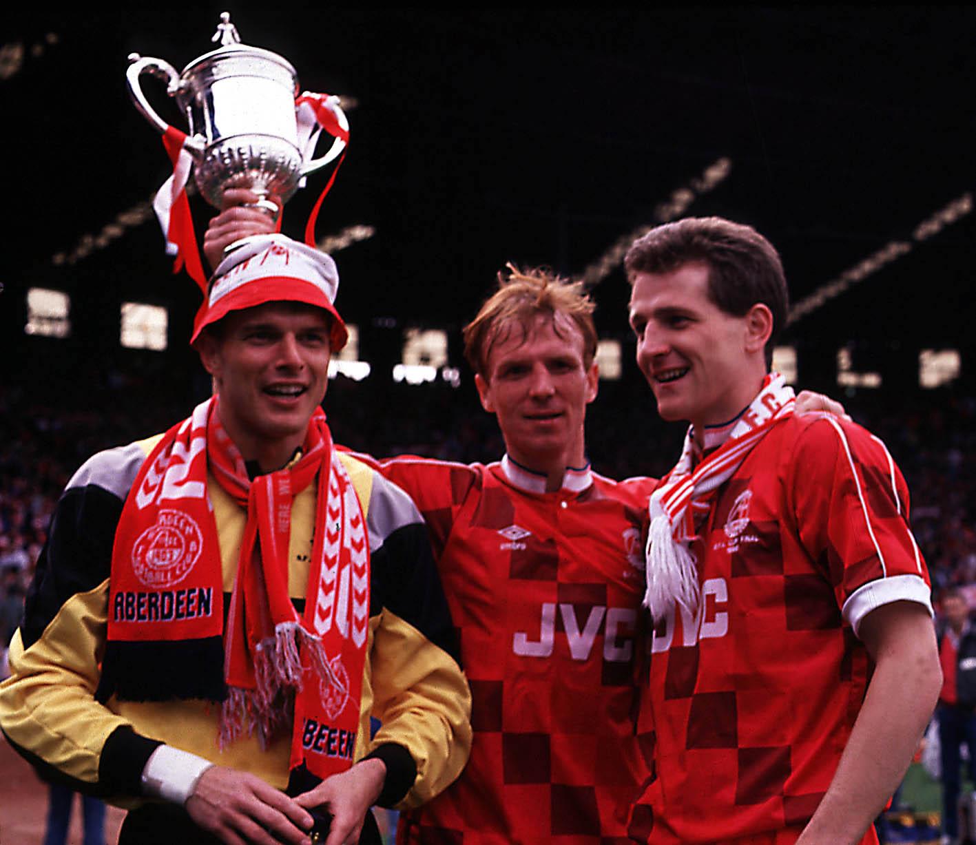 Aberdeen trio Theo Snelders, left, Alex McLeish, centre, and Brian Irvine celebrate the win in 1990.