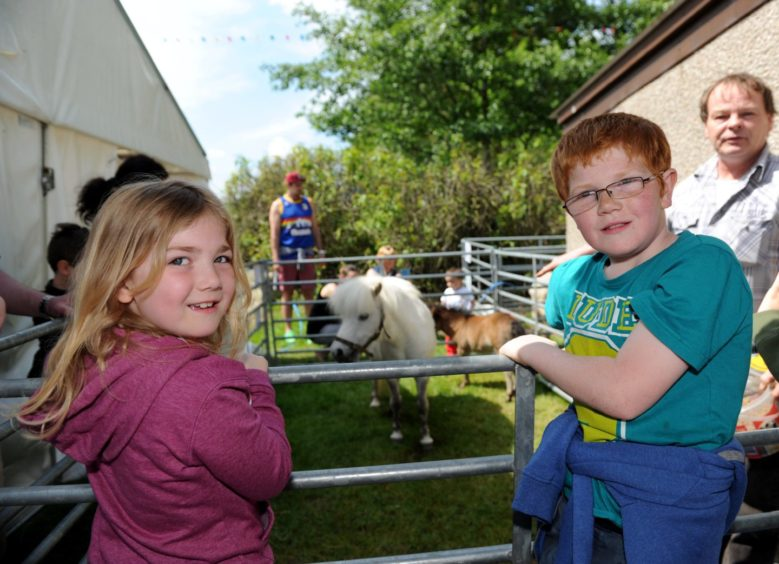 (L:R) Kirsten and Hamish Cassie admire the ponies. Picture by Kath Flannery.