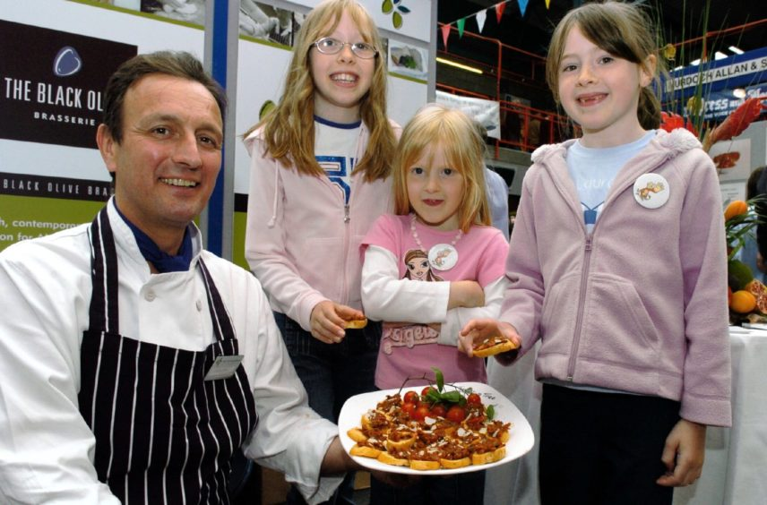 Left to right - Chef Geoff Cook, sisters - Zoe 9, Jodie 5 and Laura 6 Donald