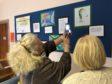 Members of the River Dee Trust judging the children's artwork