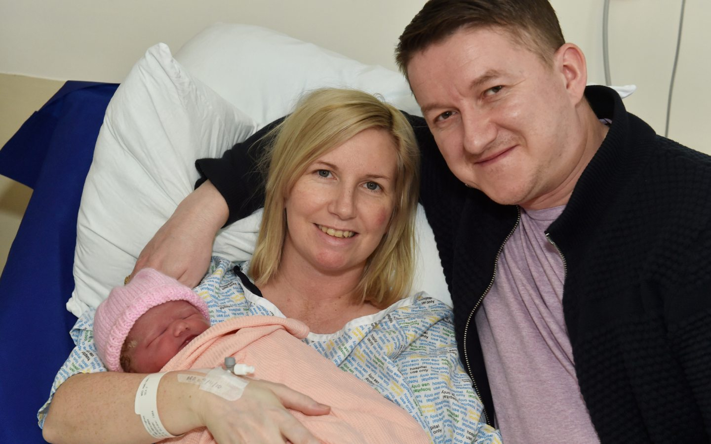 Lynda and Darren Cunningham with baby Isla James - born at 5.31am weighing at 7lb 8oz. Picture by COLIN RENNIE