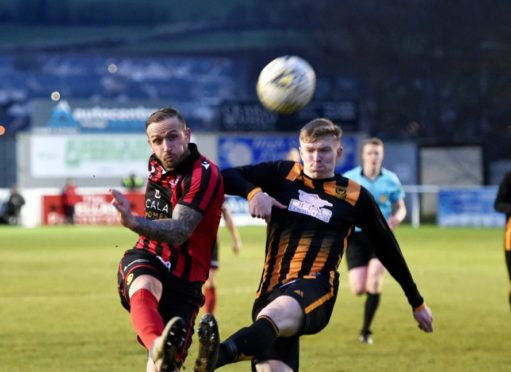 Inverurie's Jonny Smith and Huntly Logan Declam Milne. Picture by COLIN RENNIE