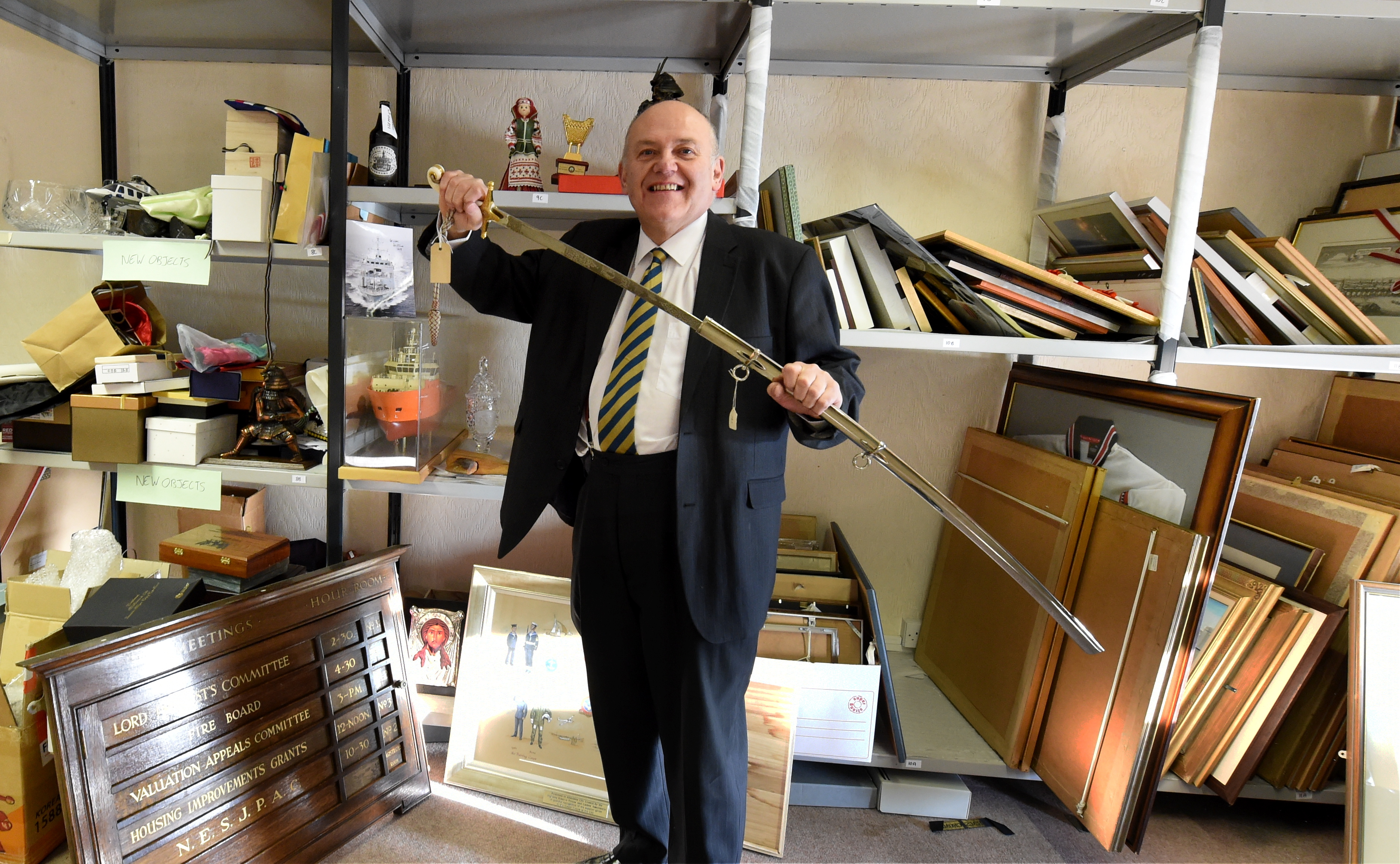 Lord Provost Barney Crockett with the sword. Pic by Jim Irvine.