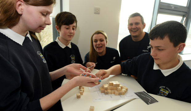 Sarah Chew, managing director of Techfest and Arne Gurtner, Equinor senior vice president UK with pupils from Aboyne Academy. Picture by Jim Irvine
