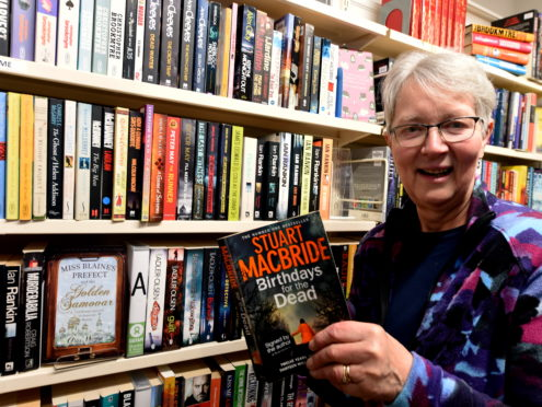 Bookshop manager Marion Cragie in Aberdeen's Back Wynd.  Picture by Jim Irvine.