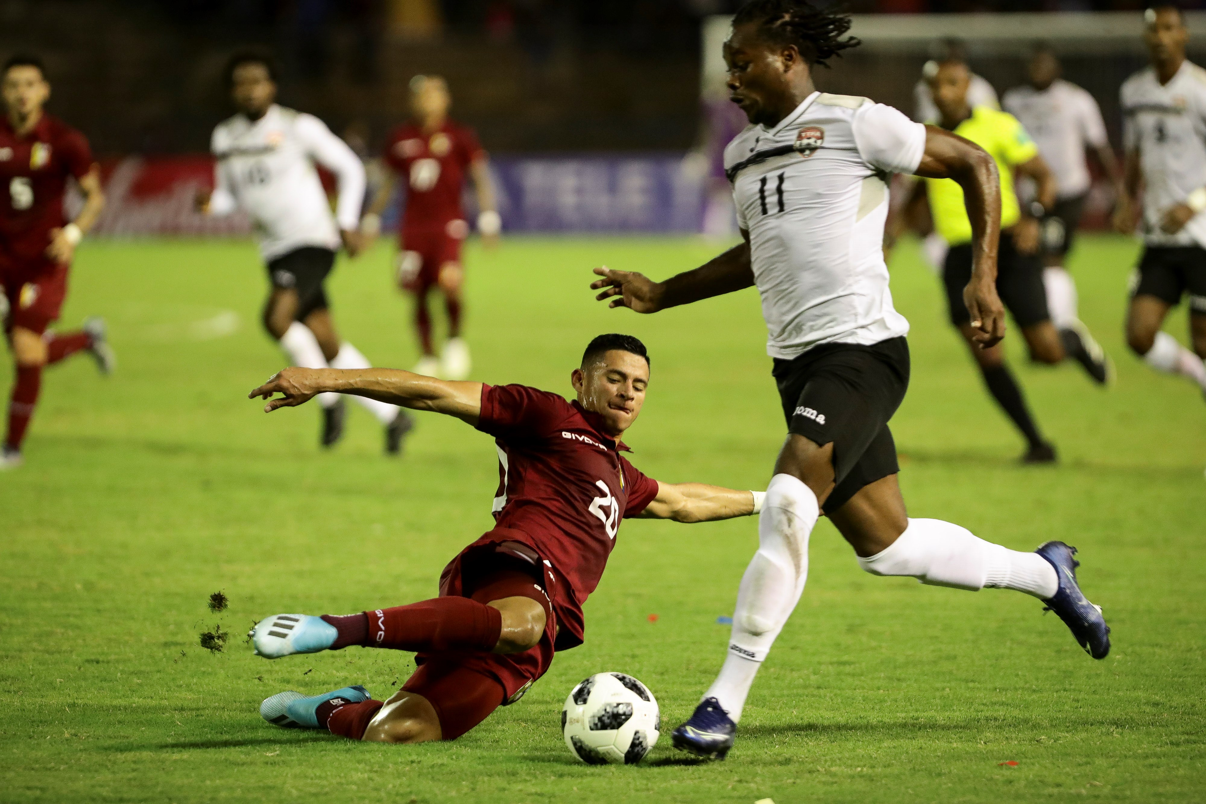 Venezuela's Ronald Hernandez (L) vies for the ball with Trinidad and Tobago's Levi Garcia (R) during a friendly.