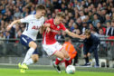 Ryan Hedges of Barnsley and Juan Foyth of Tottenham Hotspur  in action at Wembley.