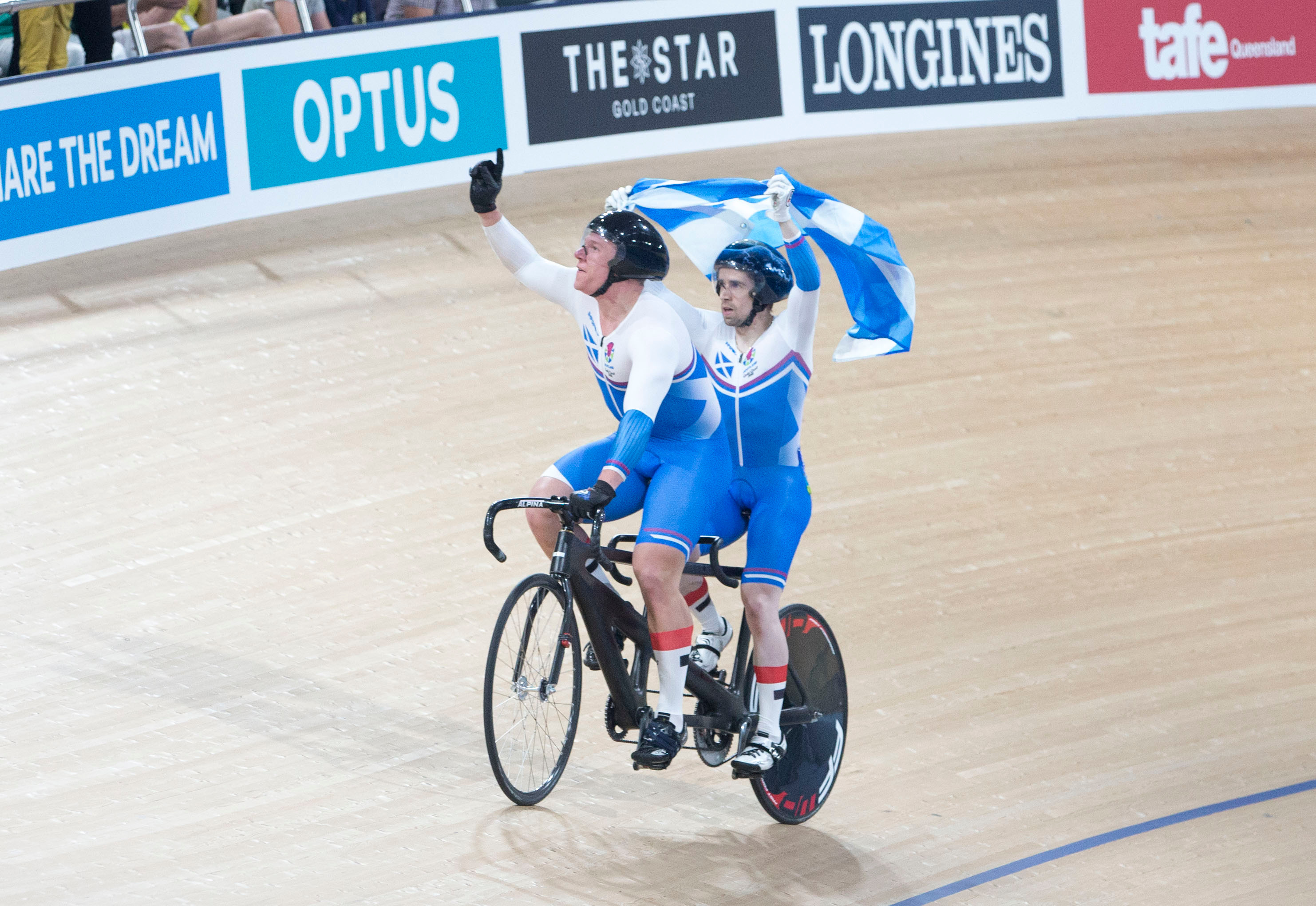 Neil Fachie and Matt Rotherham celebrate one of their wins at the 2018 commonwealth Games.