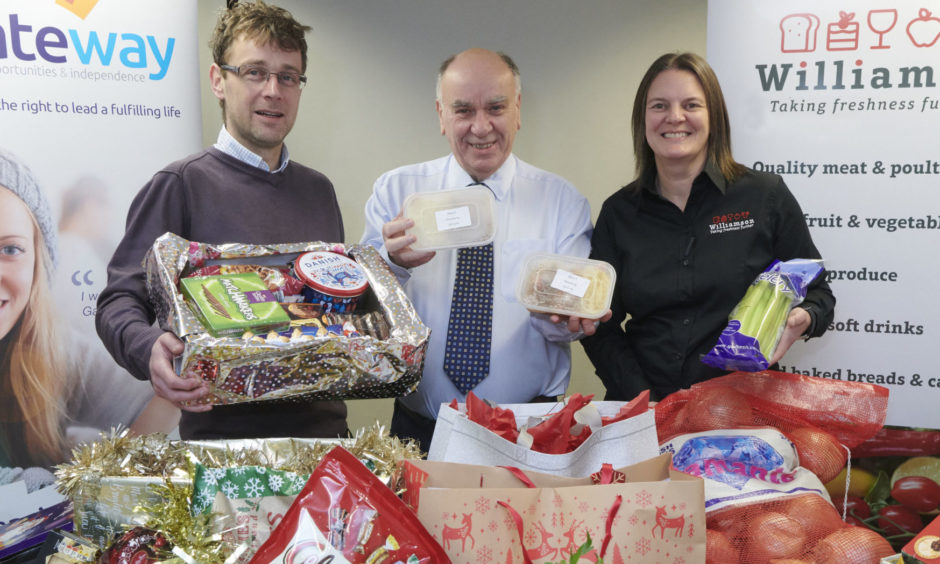 Overseeing the distribution network are Food For Families founder David Sutherland (centre) with Louise Beattie of Williamsons Food Service and Craig Riddle, finance manager of Gateway.